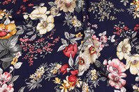 Navy viscose mousselin with flowers in soft red, off white, rust-red