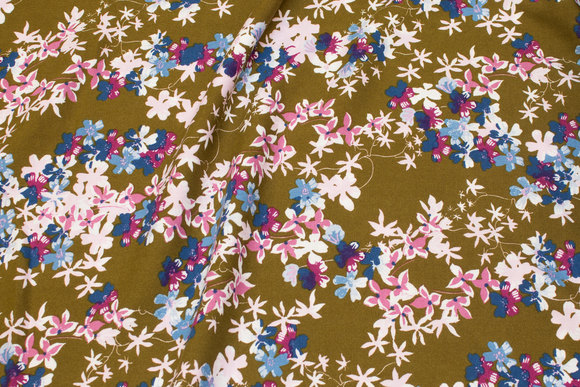 Olive-green viscose mousselin with soft red and blue flowers