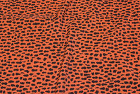Rust-colored dress-micro with small black pattern