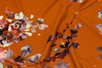 Thick scuba-jersey in cinnamon-colored with flowers