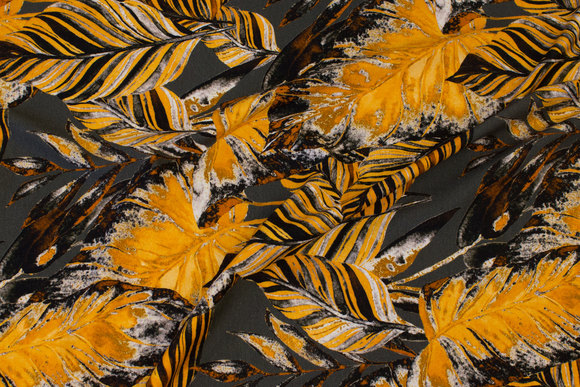Beautiful charcoal viscose-jersey with golden leaves