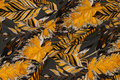 Beautiful charcoal viscose-jersey with golden leaves.