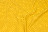 Brass-colored cotton-jersey with small yellow dot.