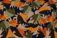 Viscose-jersey with leaves in navy, rust, green
