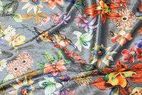 Light grey velvet-stretch with orange flowers and birds