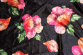 Black velvet-stretch with big red and pink flowers.