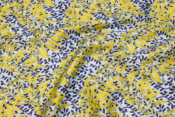 Light blue cotton satin with yellow-green leaf-pattern