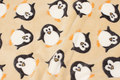 Sand-colored supersoft microfleece with penguins