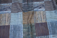 Cotton-canvas in brown, blue and eggplant-colored.