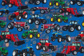 Blue cotton-jersey with tractors in red, green and blue