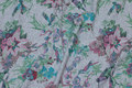 Grey-speckled, lightweight sweatshirt fabric with birds and flowers