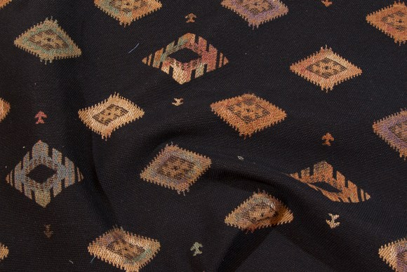 Black and rust Kelim pattern in furniture-quality