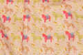 Delicate soft red cotton with horses in pink and green .
