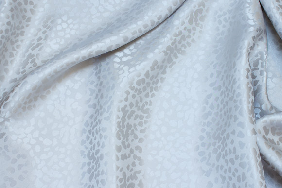 Jacquard-woven 100% silk in light sand and grey
