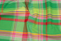 Large-checks cotton in apple-green and soft red.