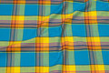 Large-checks cotton in turqoise and yellow.
