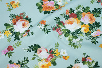 Light apple-green medium-thickness cotton and polyester with flowers