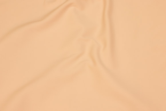 Powder-colored, smooth stretch fabric