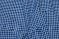 Pre-shunk blue-checks shirt-fabric.