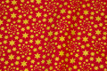 Red cotton with gold stars