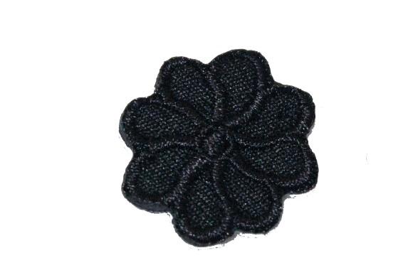 Tiny black flower iron on patch ø 2 cm