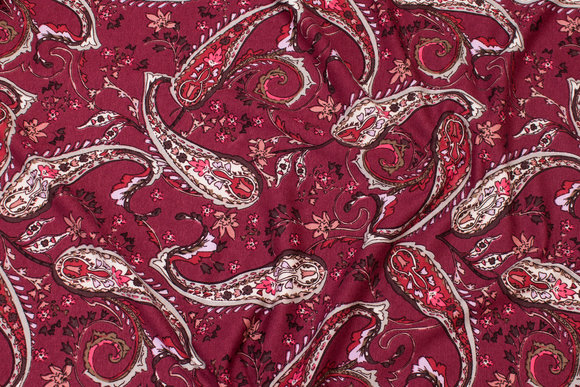 Wine-red viscosejersey with paisley pattern