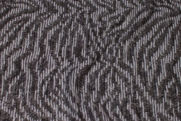 Jacquard-knit in charcoal and mint with mohairlook