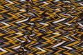 Heavyjersey with zig-zag pattern in brass, grey, black and white