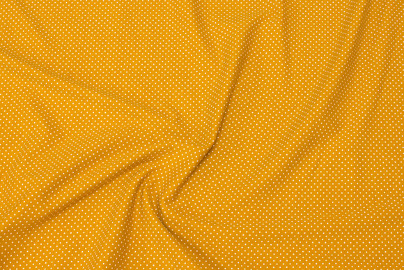 Brass-yellow cotton-jersey with light mini-dots