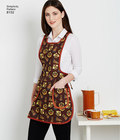 Misses´ vintage aprons from the 1970´s includes traditional shaped apron with pockets and optional ruffled lace trim, or smock style apron with or without half sleeves. Vintage Simplicity sewing pattern.