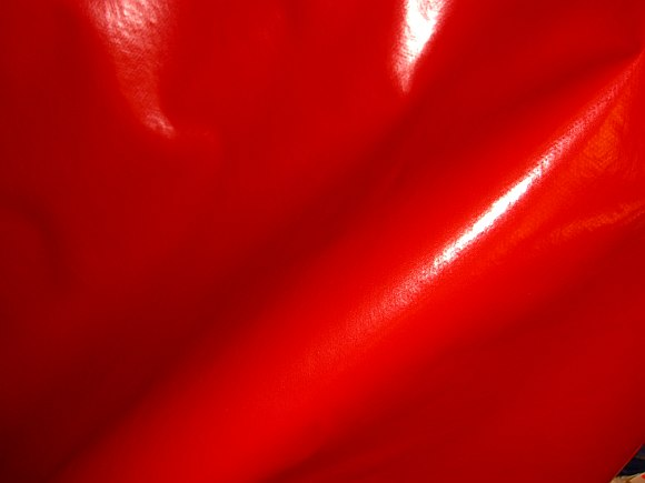 Coated fabric in bright red