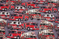 Grey cotton-jersey with beautiful red fire trucks.