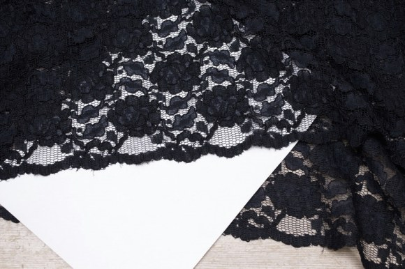 Black, beautiful lace with scallop edge in both sides