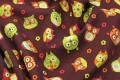 Brown cotton with cute green-red-orange owls