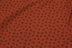 Double woven cotton (gauze) in rust-colored with small black hearts