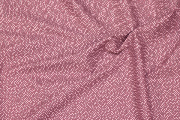 Heather-colored, firm cotton with soft red micro-dot