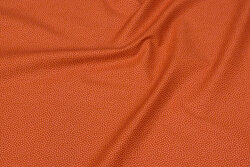 Rust-colored, firm cotton with lighter micro-dot