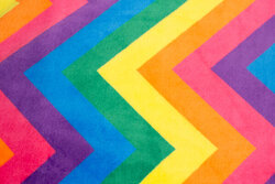 Supersoft micro-fleece with large zig zag pattern in rainbow-colors
