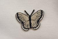 Tiny butterfly 2 x 3 cm